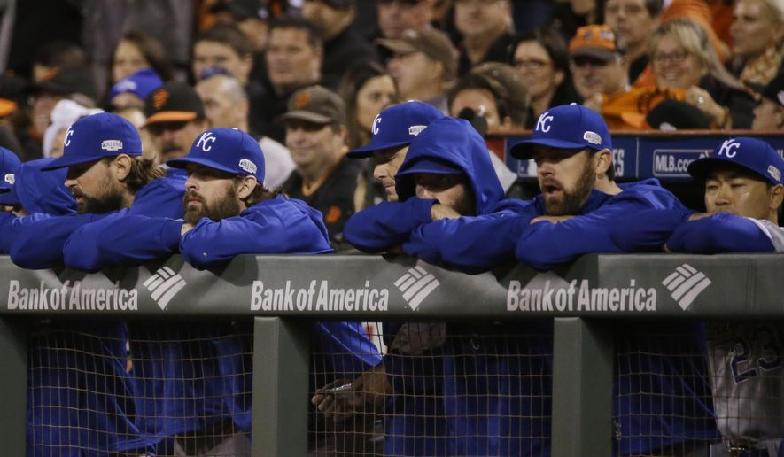 Kansas City Royals watch the ninth inning from their dugout during Game 5 of baseball's World Series against the San Francisco Giants Sunday, Oct. 26, 2014, in San Francisco. The Giants defeated the Royals 5-0 to lead the series 3-2 games. (AP Photo/Matt Slocum)