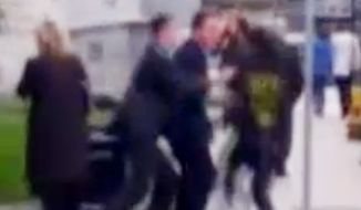A man runs into David Cameron on visit to Leeds. Photo credit: BBC