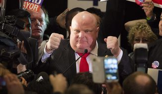 Rob Ford speaks to supporters after winning his seat on city council at mayoral candidate Doug Ford's election night headquarters in Toronto on Monday, Oct. 27, 2014.  Ford won his old seat in a landslide Monday and strongly hinted he may seek to run for mayor again in four years. (AP Photo/The Canadian Press, Darren Calabrese)