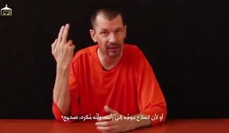 "An image from a video titled ""Lend Me Your Ears, Messages from the British Detainee John Cantlie,"" which was posted on YouTube, is seen here. Mr. Cantlie appears in a new Islamic State video, in which he is compelled to tell the camera that the terrorists have all but won the battle for the Syrian border town of Kobani."