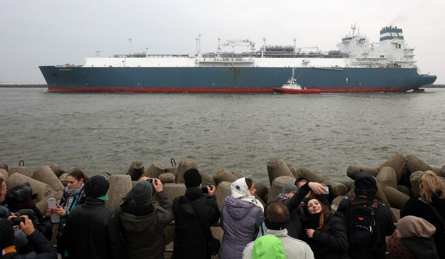 "People take photographs as ""Independence"" a Liquefied Natural Gas (LNG) storage vessel is maneuvered by tugboats through the sea gate port of Klaipeda, Lithuania, Monday, Oct. 27, 2014. The floating natural gas terminal arrived in the Lithuanian port of Klaipeda, in a move by the Baltic country to further reduce its reliance on energy supplies from Russia. (AP Photo/Kestutis Vanagas)"