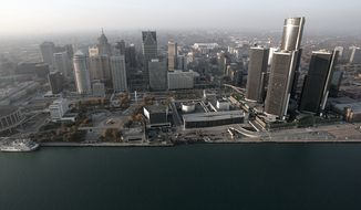 FILE - In this Nov. 2, 2005 file photo, the Detroit skyline is shown along the Detroit River. Lawyers began making their closing arguments Monday, Oct. 27, 2014 in Detroit's bankruptcy trial. Detroit filed for Chapter 9 bankruptcy protection in July 2013, becoming the largest U.S. city to ever do so. (AP Photo/Paul Sancya, File)