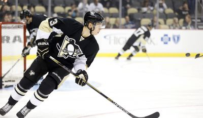 Pittsburgh Penguins' Olli Maatta (3), of Finland, warms up before the NHL hockey game between the Pittsburgh Penguins and the Anaheim Ducks on Thursday, Oct. 9, 2014 in Pittsburgh. (AP Photo/Keith Srakocic)