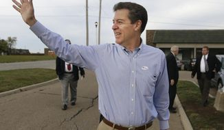 Gov. Sam Brownback, R-Kan., waves to a supporter after advance voting at the Shawnee County Elections office in Topeka, Kan., Monday, Oct. 27, 2014. Brownback is running for reelection against Democratic challenger Paul Davis. (AP Photo/Orlin Wagner)