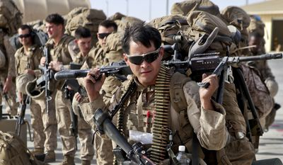 A Marine with 1st Battalion, 2nd Marine Regiment, prepares to load onto a KC-130 aircraft on the Camp Bastion flightline, Oct. 27, 2014. The battalion was the final Marine Corps infantry battalion to serve in Helmand province, Afghanistan, as the United States Marine Corps ended their operations.