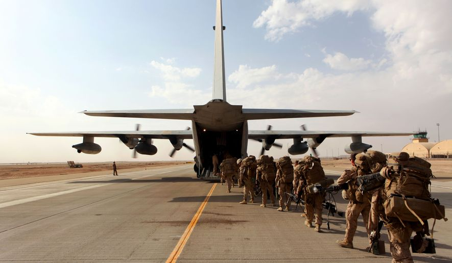 Marines and sailors with Marine Expeditionary Brigade; Afghanistan load onto a KC-130 aircraft on the Camp Bastion flightline, Oct. 27, 2014. The Marine Corps ended its mission in Helmand province, Afghanistan, the day prior and all Marines, sailors and service members from the United Kingdom withdrew from southwestern Afghanistan.