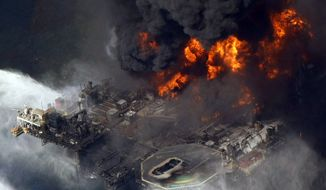 "In this April 21, 2010 file aerial photo taken in the Gulf of Mexico more than 50 miles southeast of Venice on Louisiana's tip, the Deepwater Horizon oil rig is seen burning. New research shows that the BP oil spill left an oily ""bathub ring"" on the seafloor that's about the size of Rhode Island. The study by David Valentine, the chief scientist on the federal damage assessment research ships, estimates that about 10 million gallons of oil coagulated on the floor of the Gulf of Mexico around the damaged Deepwater Horizons oil rig. Valentine said the spill left even bigger deeper oil splotches besides the ring. The rig blew on April 20, 2010 and spewed 172 million gallons of oil into the Gulf through the summer. Scientists are still trying to figure where all the oil went and what it did to the Gulf.  (AP Photo/Gerald Herbert, File)"