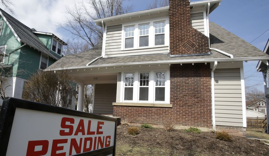 FILE - This Friday, March 21, 2014 file photo shows a home for sale in Cleveland Heights, Ohio. The National Association of Realtors releases pending home sales index for September 2014 on Monday, Oct. 27, 2014. (AP Photo/Tony Dejak, File)