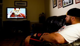 """Washington Redskins practice squad offensive lineman Tevita Stevens sits at home in Sterling, Va., as the Washington Redskins play """"Monday Night Football"""" against the Dallas Cowboys in Texas, Monday, October 27, 2014. (Andrew Harnik/The Washington Times)"""