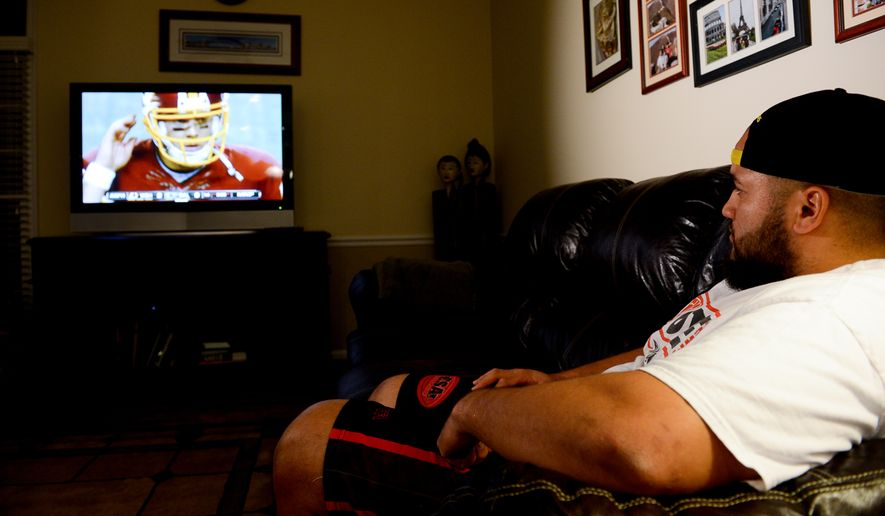 "Washington Redskins practice squad offensive lineman Tevita Stevens sits at home in Sterling, Va., as the Washington Redskins play ""Monday Night Football"" against the Dallas Cowboys in Texas, Monday, October 27, 2014. (Andrew Harnik/The Washington Times)"