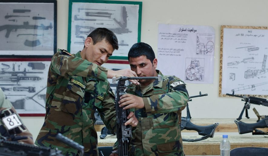 ANA special forces candidates participate in specialized training on weaponry and ordnance at the military School of Excellence near Kabul. (Photo by Valerie Plesch/Special to The Washington Times)