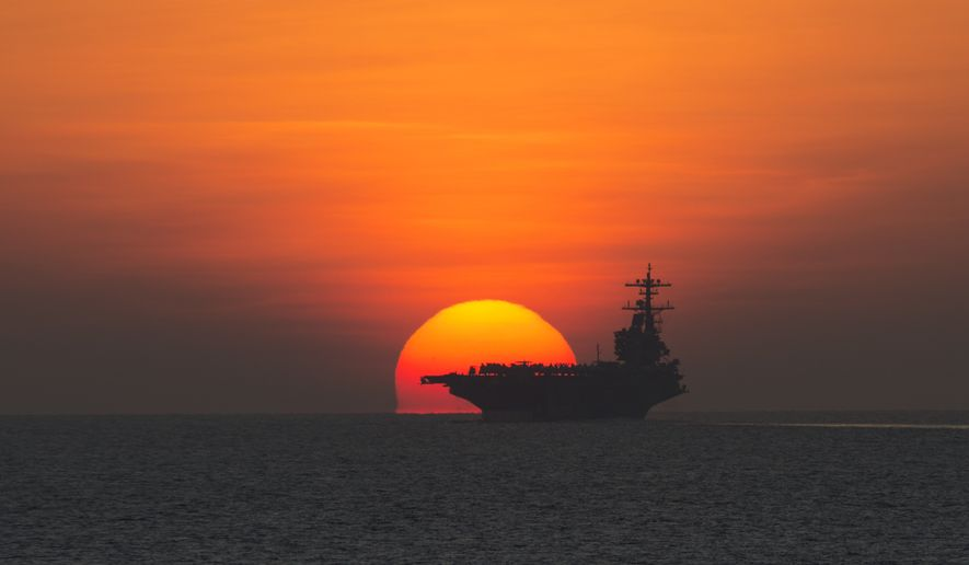 The aircraft carrier USS George H.W. Bush (CVN 77) transits the Gulf of Aden. (U.S. Navy photo by Mass Communication Specialist 2nd Class Abe McNatt/Released)