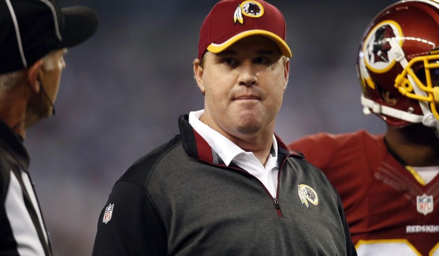 Washington Redskins head coach Jay Gruden talks to an official during the second half of an NFL football game against the Dallas Cowboys, Monday, Oct. 27, 2014, in Arlington, Texas. (AP Photo/Tim Sharp)