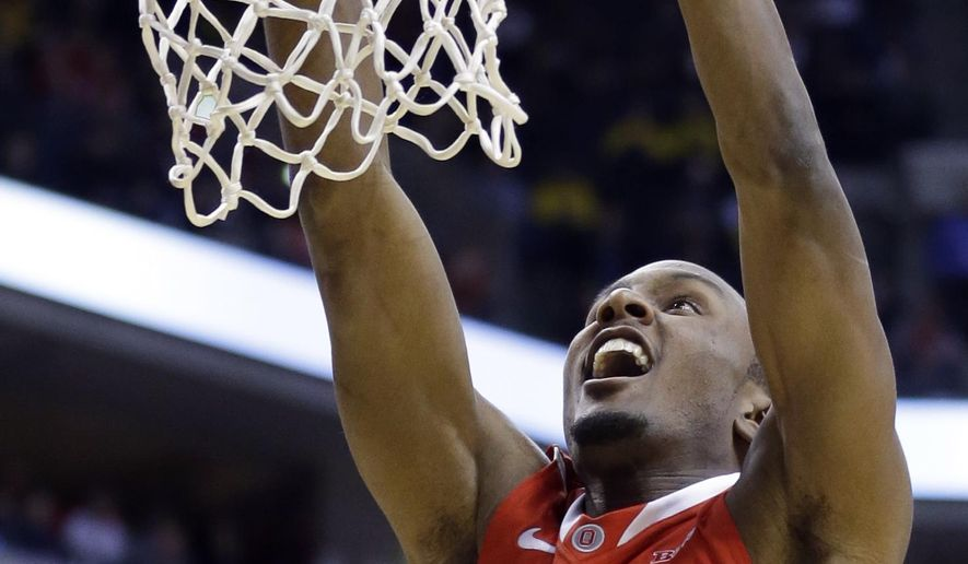 FILE - In this March 14, 2014, file photo, Ohio State forward Sam Thompson dunks during NCAA college basketball game against Nebraska in the quarterfinals of the Big Ten tournament in Indianapolis. Thompson thinks the 2014-15 team is one of the best teams he's been on since he's been at Ohio State. It has some competition from his freshman year team just because it went to the Final Four. (AP Photo/Michael Conroy, File)