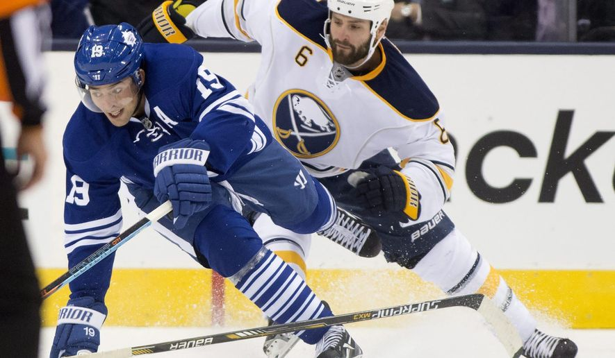 Toronto Maple Leafs' Joffrey Lupul (19) battles with Buffalo Sabres' Mike Weber (6) during the first period of an NHL hockey game, Tuesday, Oct. 28, 2014 in Toronto. (AP Photo/The Canadian Press, Frank Gunn)