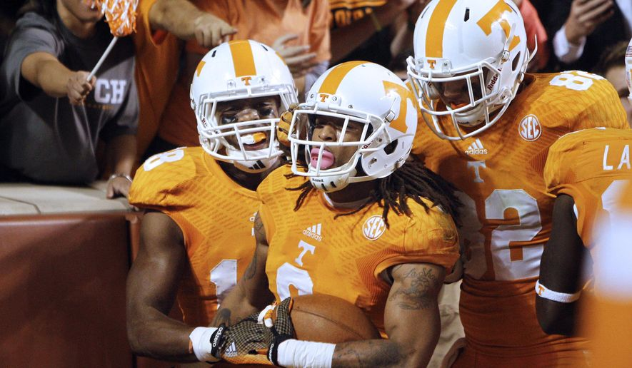Tennessee wide receiver Von Pearson (9) is congratulated by teammates Ethan Wolf (82) and Jason Croom (18) in the third quarter of an NCAA college football game against Alabama on Saturday, Oct. 25, 2014 in Knoxville, Tenn. Alabama won 34-20. (AP Photo/Wade Payne)
