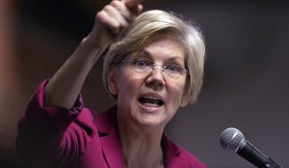 Massachusetts Senator Elizabeth Warren speaks to a rally of supporters of Kentucky senatorial candidate Alison Lundergan Grimes at the Copper & Kings Distillery in Louisville, Ky., Tuesday, Oct. 28, 2014. (AP Photo/Timothy D. Easley)