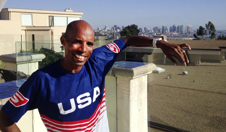 In this Tuesday, Sept. 30, 2014 photo, Meb Keflezighi poses for a photo in San Diego, Calif. Keflezighi already was a big-time marathoner, taking the silver medal at the 2004 Olympics and winning the New York City Marathon in 2009. Then came his inspirational victory in the Boston Marathon a year after the bombings there, and his life went stratospheric. (AP Photo/Bernie Wilson)