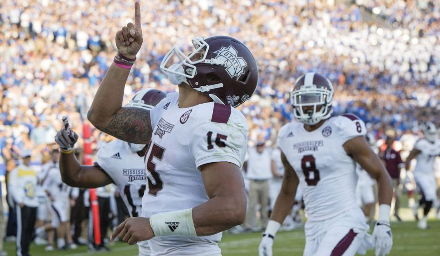 FILE - In this Oct. 25, 2014, file photo, Mississippi State quarterback Dak Prescott celebrates after running for a touchdown during the second half of an NCAA college football game against Kentucky at Commonwealth Stadium in Lexington, Ky. The first of seven top-25 rankings done by a 12-member selection committee was released Tuesday, Oct. 28, 2014. Mississippi State, Florida State, Auburn, Mississippi are the top four teams in the first College Football Playoff rankings. (AP Photo/David Stephenson, File)