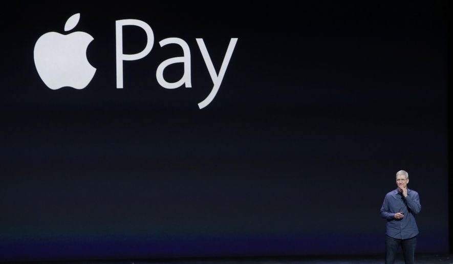 In this Sept. 9, 2014, file photo, Apple CEO Tim Cook introduces Apple Pay during an event in Cupertino, Calif. Cook on Monday, Oct. 27, 2014, said Apple's new mobile payment system had over 1 million activations in the first three days after it became available, and is now more widely used than any competing payment system. (AP Photo/Marcio Jose Sanchez, File)