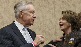 Senate Majority Leader Harry Reid of Nev., left, confers with House Minority Leader Nancy Pelosi of Calif., during an event on Capitol Hill in Washington, Thursday, April 3, 2014, to urge approval for raising the minimum wage. (AP Photo/J. Scott Applewhite) **FILE**