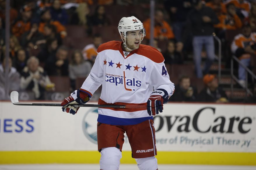 Washington Capitals' Tom Wilson in action during an NHL hockey game against the Philadelphia Flyers, Tuesday, Dec. 17, 2013, in Philadelphia. (AP Photo/Matt Slocum)