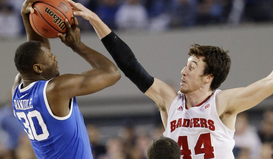 FILE - In this April 5, 2014, file photo, Wisconsin forward Frank Kaminsky (44) blocks a shot by Kentucky forward Julius Randle (30) during the second half of the NCAA Final Four tournament college basketball semifinal game in Arlington, Texas. The one-point loss to Kentucky in the Final Four still stings for Kaminsky. But instead of stewing all offseason about his team being one possession short of playing for a national title, Kaminsky says it's all about motivation. (AP Photo/Eric Gay, File)