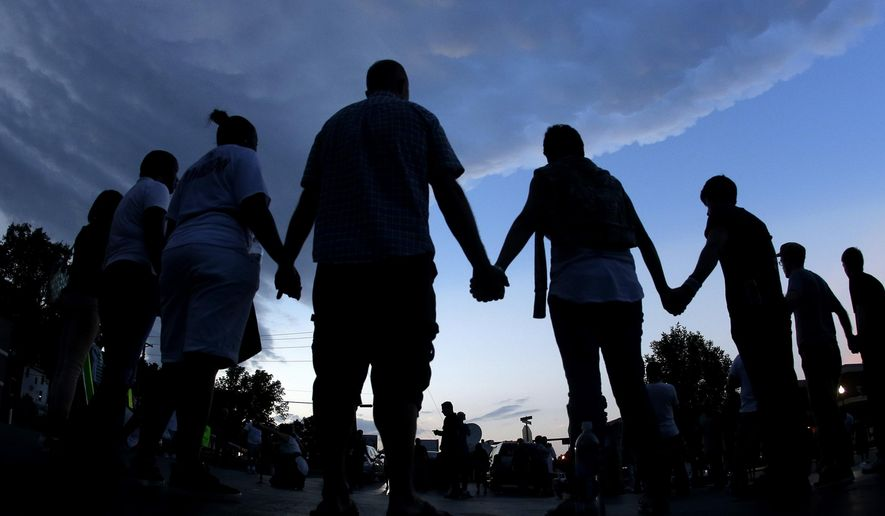 """""""I pray that our neighbors in Missouri will take this chance to help change us for the better by choosing to overcome wrong with right, evil with good and hate with love,"""" writes Christy Stutzman. (AP Photo/Charlie Riedel, File)"""