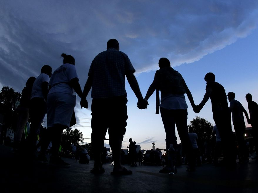 """I pray that our neighbors in Missouri will take this chance to help change us for the better by choosing to overcome wrong with right, evil with good and hate with love,"" writes Christy Stutzman. (AP Photo/Charlie Riedel, File)"