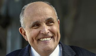 Lawyer and former New York City Mayor Rudy Giuliani speaks at a press conference in this Thursday, Oct. 16, 2014, file photo. (AP Photo/Damian Dovarganes, File)