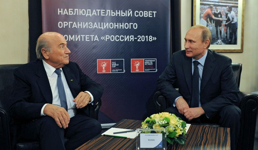 Russian President Vladimir Putin, right, and FIFA President Sepp Blatter speak during their meeting in Moscow, Russia, Tuesday, Oct. 28, 2014. Putin and Blatter on Tuesday visited  the Luzhniki Stadium which is under reconstruction for the final of the 2018 World Cup. The sign reads Russia-2018 Local Organizing Committee.  (AP Photo/RIA-Novosti, Mikhail Klimentyev, Presidential Press Service)