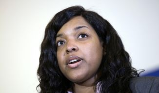 Amber Vinson, 29, the Dallas nurse who was being treated for Ebola, speaks at a news conference after being discharged from Emory University Hospital, Tuesday, Oct. 28, 2014, in Atlanta. Vinson worked as a nurse at Texas Health Presbyterian Hospital Dallas and cared for Thomas Eric Duncan, a Liberian man who died of Ebola at the hospital on Oct. 8. Vinson was one of two nurses who became infected while caring for Duncan. (AP Photo/David Goldman)