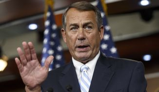 """FILE - In this July 31, 2014 file photo, House Speaker John Boehner speaks during a news conference on Capitol Hill in Washington. After the Federal Reserve began buying $600 billion in U.S. government bonds in November 2010 as part of its expanded quantitative easing program, Boehner argued that the central bank risked creating """"hard-to-control"""" inflation, a weak U.S. dollar and market bubbles. (AP Photo/J. Scott Applewhite, File)"""