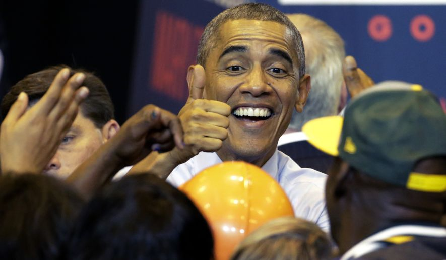 President Barack Obama gives a thumbs up to supporters as he campaigns for Wisconsin Democratic gubernatorial candidate Mary Burke during a rally at the North Division High School, Tuesday, Oct. 28, 2014, in Milwaukee. (AP Photo/Charles Rex Arbogast)