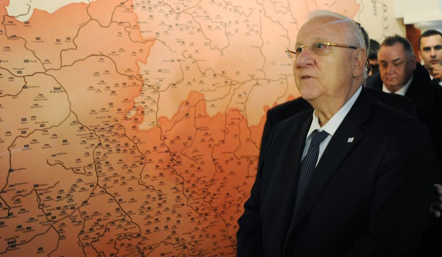 Israeli President Reuven Rivlin walks past a historical map of Poland as he tours the POLIN Museum of the History of Polish Jews during the opening of the core exhibition, in Warsaw, Poland, Tuesday, Oct. 28, 2014. (AP Photo/Alik Keplicz)