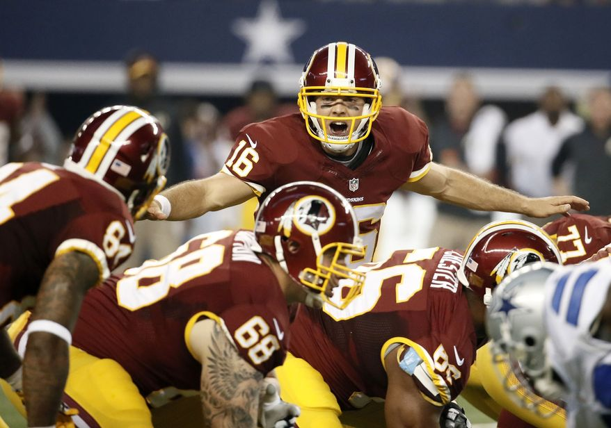 Washington Redskins' Colt McCoy instructs the line of scrimmage during the first half of an NFL football game against the Dallas Cowboys, Monday, Oct. 27, 2014, in Arlington, Texas. (AP Photo/Brandon Wade)