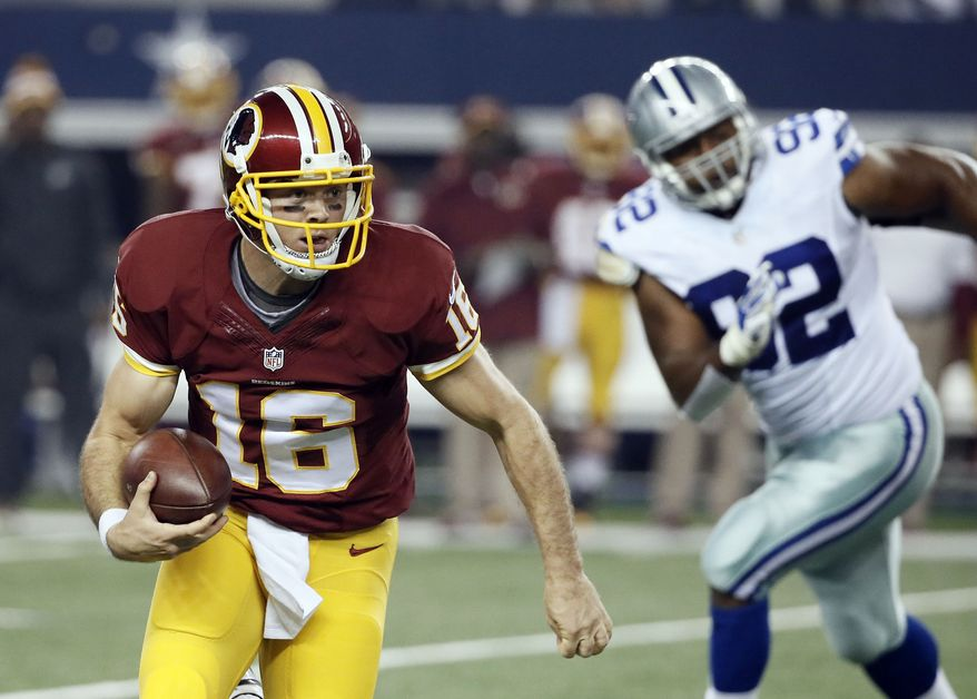 Washington Redskins quarterback Colt McCoy (16) scrambles out of the pocket under pressure from Dallas Cowboys defensive end Jeremy Mincey (92) during the first half of an NFL football game, Monday, Oct. 27, 2014, in Arlington, Texas. (AP Photo/Brandon Wade)