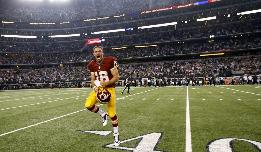 Washington Redskins' Colt McCoy (16) celebrates on the field after their 20-17 overtime win in an NFL football game against the Dallas Cowboys, Monday, Oct. 27, 2014, in Arlington, Texas. (AP Photo/Tim Sharp)