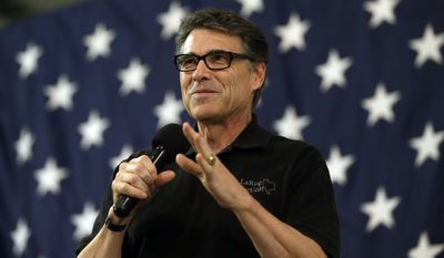 Texas Gov. Rick Perry speaks during a conservative rally in Smithfield, N.C., in this Oct. 24, 2014, file photo. (AP Photo/Gerry Broome, File)