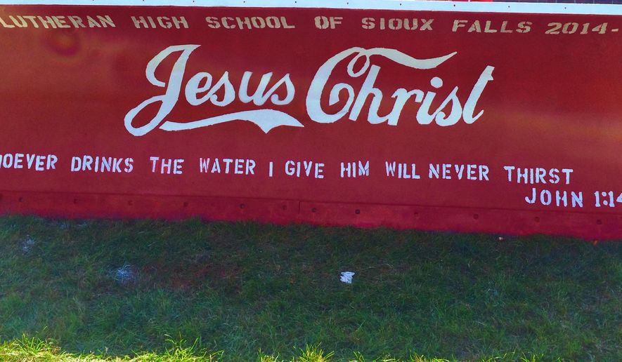 This Sept. 19, 2014, photo provided by the Lutheran High School of Sioux Falls, shows a plow blade painted by students from Lutheran High School of Sioux Falls for the city's Paint the Plows program, in Sioux Falls, S.D. The mayor of Sioux Falls says the city won't paint over religious messages that parochial school students put on city-owned snow plow blades unless it is legally forced to do so. (AP Photo/Lutheran High School of Sioux Falls)