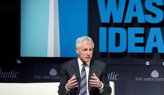 "Defense Secretary Chuck Hagel speaks at the sixth annual ""Washington Ideas Forum"" in Washington, Wednesday, Oct. 29, 2014. Hagel has approved a recommendation by military leaders that all U.S. troops returning from Ebola response missions in West Africa be kept in supervised isolation for 21 days. The move goes beyond precautions recommended by the Obama administration for civilians, although President Barack Obama has made clear he feels the military's situation is different from that of civilians, in part because troops are not in West Africa by choice.  (AP Photo/Manuel Balce Ceneta)"