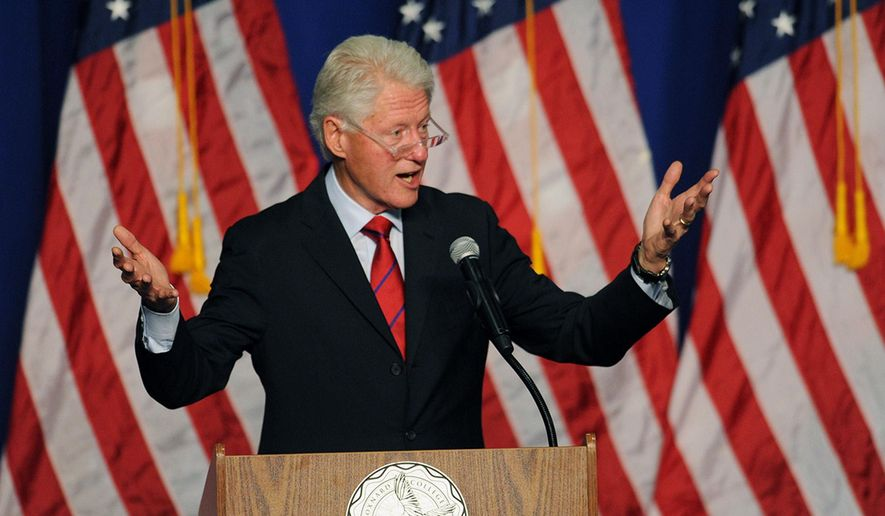 Former President Bill Clinton speaks at a Get Out the Vote rally in the Oxnard College gym in Oxnard, Calif., Wednesday, Oct. 29, 2014. Clinton came to the aid of California's vulnerable congressional Democrats stumping for two House members facing tough re-election contests. (AP Photo/Ventura County Star, Rob Varela)