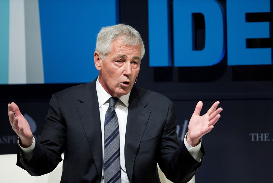 """Defense Secretary Chuck Hagel speaks at the sixth annual """"Washington Ideas Forum"""" in Washington, Wednesday, Oct. 29, 2014. Hagel has approved a recommendation by military leaders that all U.S. troops returning from Ebola response missions in West Africa be kept in supervised isolation for 21 days. The move goes beyond precautions recommended by the Obama administration for civilians, although President Barack Obama has made clear he feels the military's situation is different from that of civilians, in part because troops are not in West Africa by choice.  (AP Photo/Manuel Balce Ceneta)"""