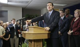 FILE - In this Oct. 16, 2014 file photo, U.S. Sen. Ted Cruz (R-Texas) is surrounded by preachers as he addresses a crowd at a Houston church regarding a legal dispute five pastors fighting subpoenas from Houston city attorneys demanding they turn over copies of any sermons they delivered that relate to Houston's equal rights ordinance. Houston's mayor says the city has withdrawn subpoenas seeking the speeches and other information. (AP Photo/Pat Sullivan, File)