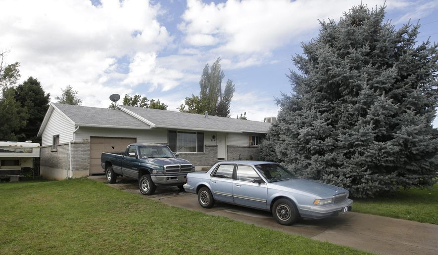 FILE - In this, Sept. 28, 2014, file photo, shows the home where five Utah family members found dead in their home, in Springville, Utah. Police say the deaths of five members of a Utah family whose bodies were found last month do not appear to be accidental or natural. Court documents obtained Wednesday show the five members of the Strack family, including three children, were found in their Springville home, covered in bedding with cups of red liquid next to the bodies. (AP Photo/Rick Bowmer, File)