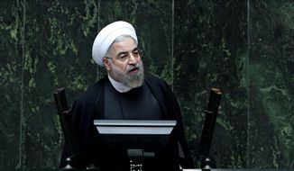 Iranian President Hassan Rouhani speaks during a debate on a vote of confidence for his choice for new minister of Science, Research and Technology Mahmoud Nili Ahmadabadi, in an open session of parliament in Tehran, Iran, Wednesday, Oct. 29, 2014. (AP Photo/Ebrahim Noroozi)