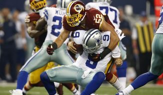 Dallas Cowboys quarterback Tony Romo (9) is sacked by Washington Redskins inside linebacker Keenan Robinson (52) during the second half of an NFL football game, Monday, Oct. 27, 2014, in Arlington, Texas. Romo suffered an unknown injury during the play. (AP Photo/Tim Sharp)
