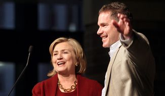 Former Secretary of State Hillary Rodham Clinton, left, campaigns with  Rep. Bruce Braley, D-Iowa,  who is running for the U.S. Senate during a stop at the RiverCenter in Davenport, Iowa, Wednesday October 29, 2014.  (AP Photo/The Quad City Times,Jeff Cook)