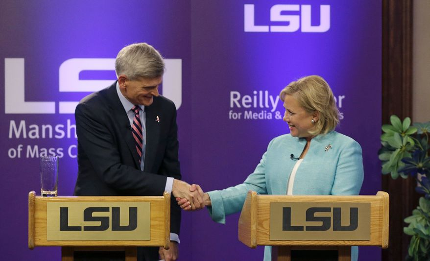 Sen. Mary Landrieu, D-La., right,  and Rep. Bill Cassidy, R-La., shake hands at the conclusion of their Senate race debate with  Republican candidate and Tea Party favorite Rob Maness on the LSU campus in Baton Rouge, La., Wednesday, Oct. 29, 2014. (AP Photo/Gerald Herbert)