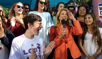 Students cheer as Sen. Wendy Davis, Democratic candidate for governor, gets ready to speak to students at a plaza at Texas A&M University-Corpus Christi during a campaign stop in Corpus Christi, Texas on Wednesday, Oct. 29, 2014. (AP Photo/Corpus Christi Caller-Times, Michael Zamora)